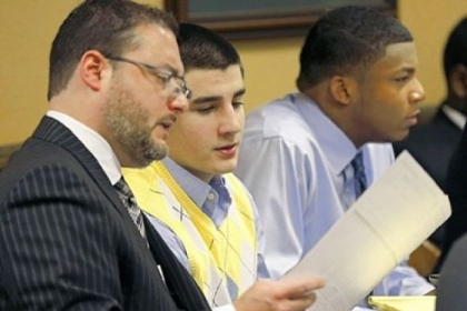 From left, defense lawyer Adam Nemann looks over evidence with defendant Trent Mays, 17, center, sitting next to defendant Malik Richmond, 17, during the trial in Steubenville on Thursday.