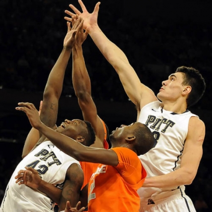 Pitt's Talib Zanna and Steven Adams reach for a rebound against Syracuse' Baye Moussa Keita in the first half of the Big East Championship quarterfinals at Madison Square Garden today. Pitt lost, 62-59.