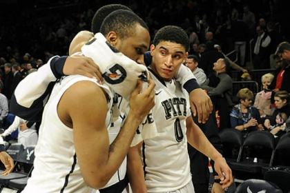 Pitt's Trey Zeigler and James Robinson walk off the floor after losing to Syracuse in the Big East Championship quarterfinals at Madison Square Garden today.