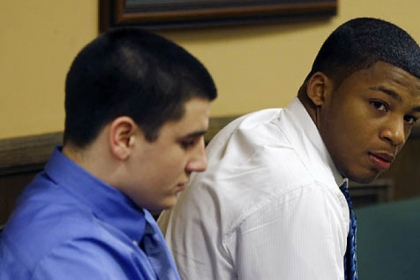 Trent Mays, 17, left, and co-defendant 16-year-old Ma&#039;lik Richmond sit in court before the start of the third day of their trial on rape charges in juvenile court today in Steubenville, Ohio.