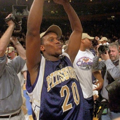 Brandin Knight holds up the trophy after Pitt defeated Connecticut to win the Big East tournament in 2003.