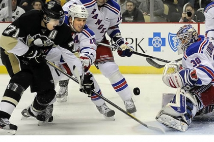 Penguins center Evgeni Malkin tries to get a shot on Rangers goaltender Henrik Lundqvist.