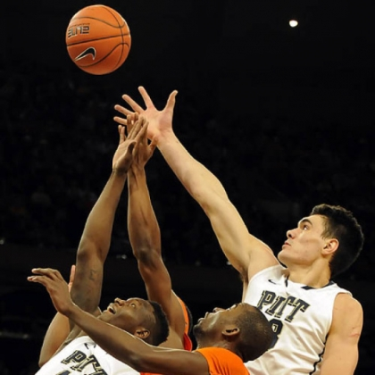 Pitt's Talib Zanna and Steven Adams reach for a rebound against Syracuse's Baye Moussa Keita in the first half of the Big East Championship quarterfinals at Madison Square Garden Thursday afternoon.
