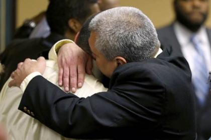 Trent Mays, 17, left, gets a hug from his father. Trent and co-defendant Malik Richmond, 16, were found delinquent for rape.