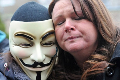 Christine Dennison, right, of Brilliant, Ohio, and a masked protestor outside the Jefferson County Justice Center respond to the delinquent decision.