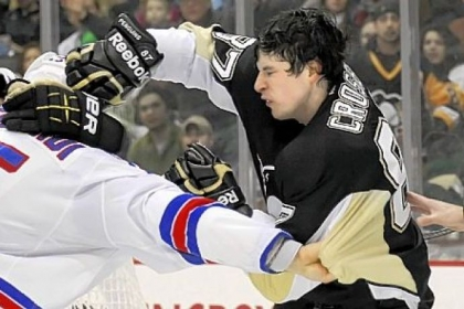 Sidney Crosby can get the Penguins going in a variety of ways. Saturday, he took on the Rangers' Dan Girardi behind the net. Both were sent to the penalty box.