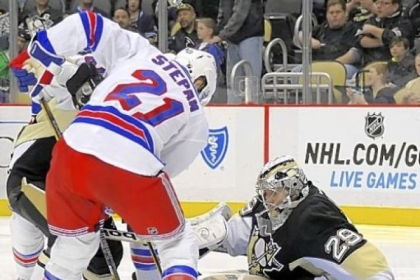 Marc-Andre Fleury stops New York's Derek Stepan in the second period - one of his 23 saves - en route to his franchise-record 23rd career shutout at Consol Energy Center.