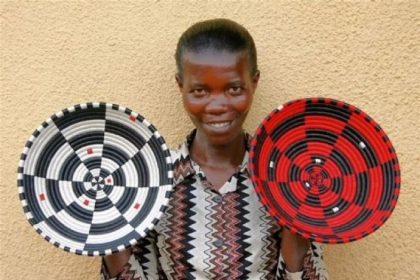 Gahaya Links cooperative member Aristude Mukashyaka, displaying her baskets, 2009.