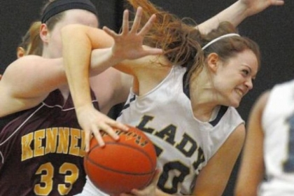 Vincentian Academy's Brenna Wise, right, rips a rebound away from Kennedy Catholic's Courtney Sargent in a Class A quarterfinal game at North Allegheny.