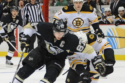 The Penguins' Sidney Crosby makes a move past the Bruins' Johnny Boychuck.