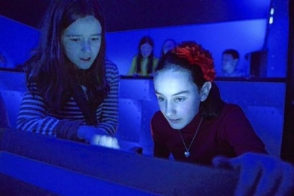 Fifth-graders Anna Rosso, 10, and Mary Flint, 10, use the simulator.