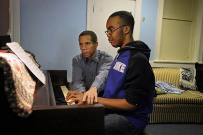 Eugene Perry teaches piano to Travonne Henderson, 14, of West Oakland, at The Corner, on Robinson Street at Terrace Street, which serves as a community center run by the West Oakland Neighborhood Council and Friendship Community Presbyterian Church.