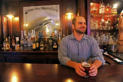 Brad Palmisiano hosts guests at his third story custom built bar called Upper Pius Men's Club.