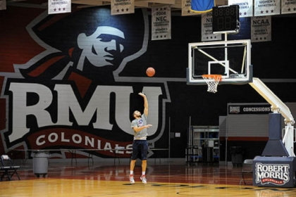 Robert Morris University basketball player Shane Sweigart takes advantage of the empty gym to get some shots in before the team's practice Monday.