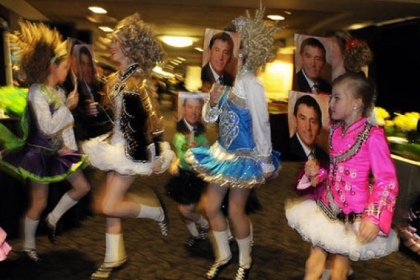 Burke Conroy Irish Dancers perform with face masks of David Malone.