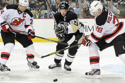 The Penguins' Sidney Crosby splits the Devils defense in the first period against New Jersey Feb. 2 at the Consol Energy Center.