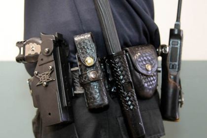 A typical Pittsburgh Police officer's belt. From left: Taser, pepper spray, collapsable baton, handcuffs, radio. Located on the other side: handcuffs .40 cal Glock automatic pistol, extra ammunition, rubber gloves and CPR mask. Missing is a flashlight. The items are arranged by the officer for their convenience.