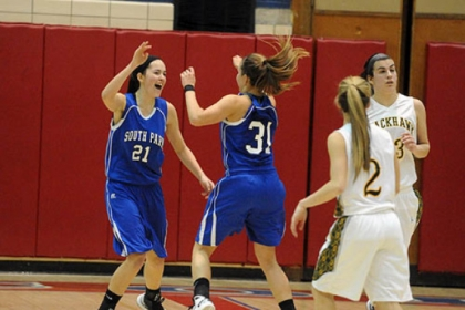 Halie Torris, left, and Shelby Lindsay of South Park celebrate as Blackhawk players leave the court Tuesday night.