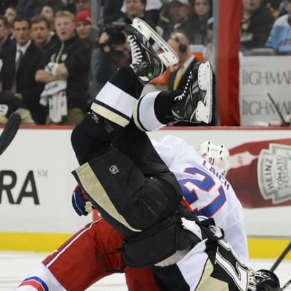 Brooks Laich of the Washington Capitals knocks Sidney Crosby head over heels in the first period Tuesday at Consol Energy Center. Crosby had the final say, though, with two assists in the Penguins&#039; 10th consecutive victory, a 2-1 win.