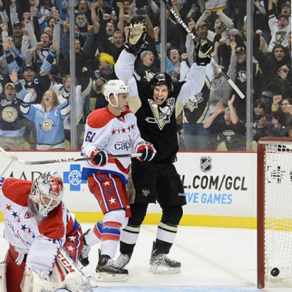 Sidney Crosby celebrates his assist on the Penguins&#039; winning goal by Matt Niskanen in the third period against the Capitals.