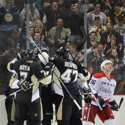 Teammates mob Paul Martin (7) after his second-period goal Tuesday against the Capitals. The Penguins won, 2-1, for their 10th victory in a row.