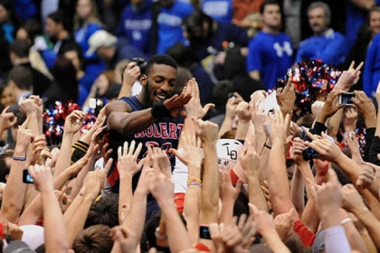 Robert Morris' Lucky Jones is lifted on top of the shoulders of the crowd after defeating Kentucky in the first round of the NIT.