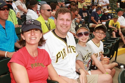From left, Suzanne and Neil Alexander enjoy a Pirates spring training game with their daughter Abby, 11, and son Patrick, 9, at McKechnie Field in Bradenton, Fla.