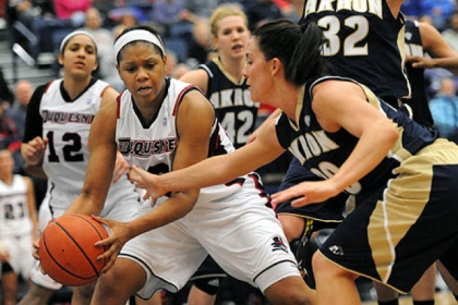Duquesne's Wumi Agunbiade, left, keeps the rebound away from Akron's Taylor Ruper, right, in second half action.