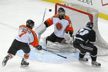 Latrobe goalie Shane Brudnok blocks a shot by Pine-Richland's Drew Berkhoudt in the Class AA Penguins Cup game Wednesday night at Consol Energy Center.