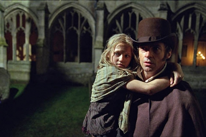 "Isabelle Allen is young Cosette and Hugh Jackman is Jean Valjean in Tom Hooper's film version of ""Les Miserables."""