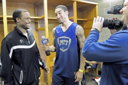 Pitt guard Cameron Wright turns the microphone on assistant coach Brandin Knight in the locker room as the Panthers prepare for their NCAA second-round game against Wichita State.
