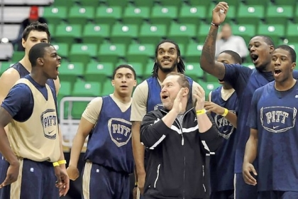 Pitt players cheer after Durand Johnson, left, hits a half-court shot to end practice Wednesday in Salt Lake City.