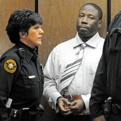 Ronald Robinson is escorted from Judge Kevin Sasinoski&#039;s courtroom for a lunch recess on the first day of his murder trial Thursday.