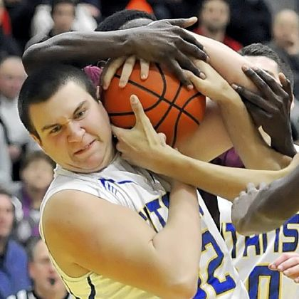 West Mifflin&#039;s Michael Peterson fights for a rebound against Steel Valley Tuesday night in a WPIAL Class AAA Section 4 game.