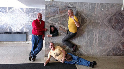 Four 1976 Penn Hills graduates recreate a photo taken during their senior year of high school during a tour of the building held on Friday.