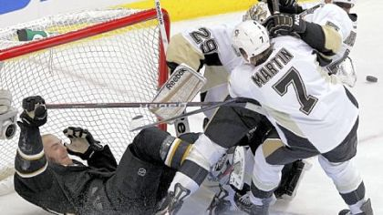 Paul Martin knocks Dallas Stars left wing Eric Nystrom into the net during a game in Dallas on Feb. 29.