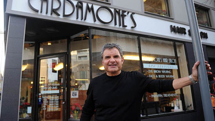 Joe Cardamone, owner of Cardamones Hair Salon, shows off his shop, one of several buildings that participated in the Pittsburgh Downtown Partnerships Paris to Pittsburgh Facade Grant Program, on Forbes Avenue in Downtown Pittsburgh.