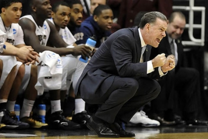 Pitt head coach Jamie Dixon yells out to his team as they take on Wichita State in the first half of the second round of the NCAA tournament at Energy Solutions Arena.