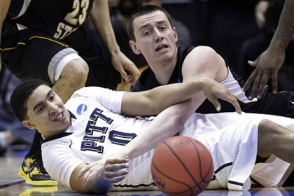 Pitt&#039;s James Robinson and Wichita State&#039;s Jake White go after a loose ball during this afternoon&#039;s NCAA tournament game in Salt Lake City. Pitt lost 73-55.
