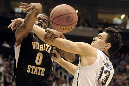 Pitt&#039;s Steven Adams reaches for a rebound against Wichita State&#039;s Chadrack Lufile in the first half.