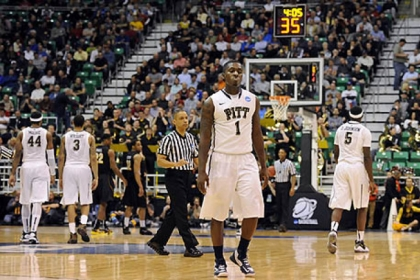 Pitt&#039;s Tray Woodall walks off the floor after fouling out against Wichita State in the second half of the second round of the NCAA tournament at Energy Solutions Arena.