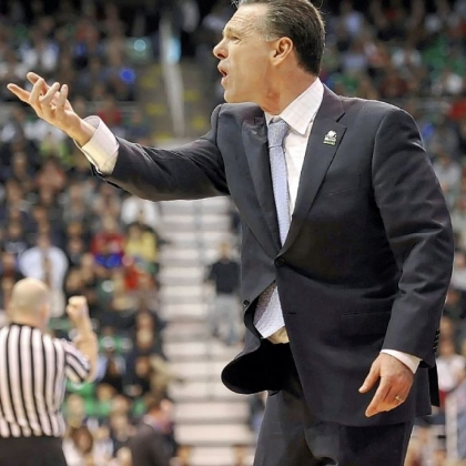 Pitt coach Jamie Dixon questions a call in the second half of his team's loss to Wichita State Thursday at EnergySolutions Arena in Salt Lake City.