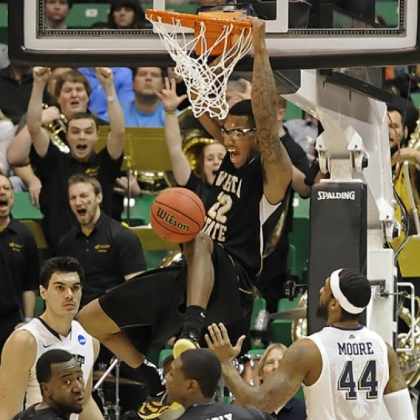 Wichita State's Carl Hall dunks against Pitt in the second half of the second round of the NCAA tournament at EnergySolutions Arena. Wichita State knocked Pitt out of the tournament with a 73-55 victory.