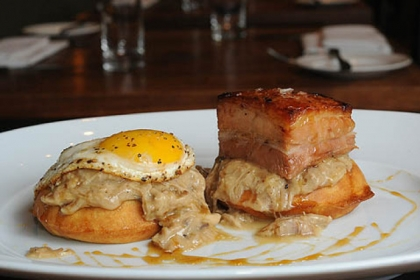 At Eleven in the Strip District, the brunch mainstay is called the Breakfast Dish:  waffles, chicken gravy, pork belly, fried egg and maple.