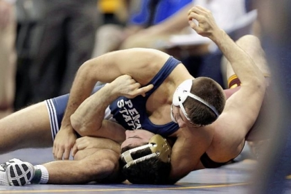 Penn State's Quentin Wright, top, pins Minnesota's Scott Schiller in their 197-pound quarterfinal match at the NCAA wrestling championships Friday in Des Moines, Iowa.