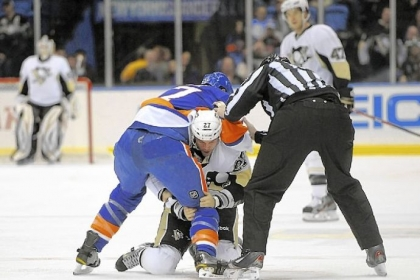 A referee separates the Islanders' Matt Martin and the Penguins' Craig Adams Friday.
