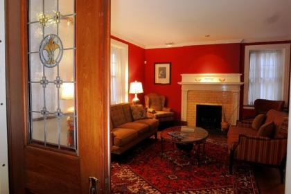 Pocket doors with added stained glass lead into the living room of the Lagneses' house in Highland Park.
