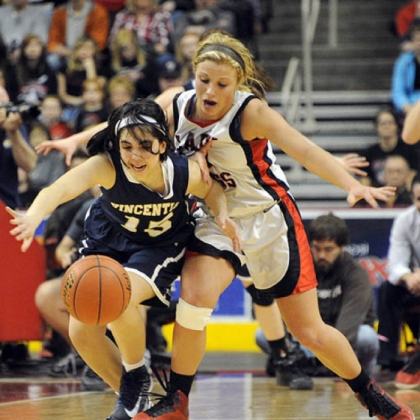 Vincentian Academy's Abbey Bartoszewicz, left, battles for the loose ball with Tri-Valley's Juli Weber in the second half of the PIAA Class A basketball championship game at Giant Center in Hershey, Pa.
