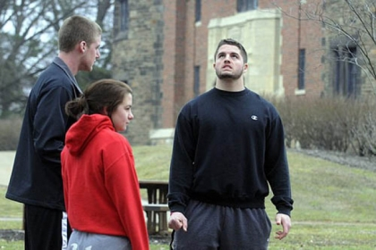 Seton Hill University students, from left, Dylan Everett, 18, Julia Chessa, 19, and Tyler Zimmer, 20, talk Saturday while on campus about the bus crash that had happened earlier in the day.
