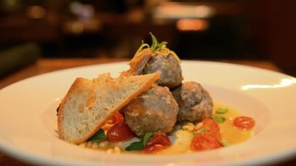 Polpette di vitello -- veal meatballs with tomatoes, pine nuts and lemon, is on the menu at Girasole.